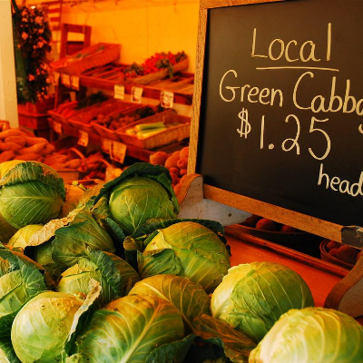 cabbages for sale at a local greengrocer